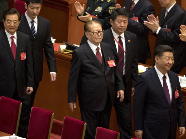 Chinese President Xi Jinping, (enters) enters the opening ceremony of the 19th Party Congress ahead of his predecessors Jiang Zemin (center) and Hu Jintao (left) on Wednesday.