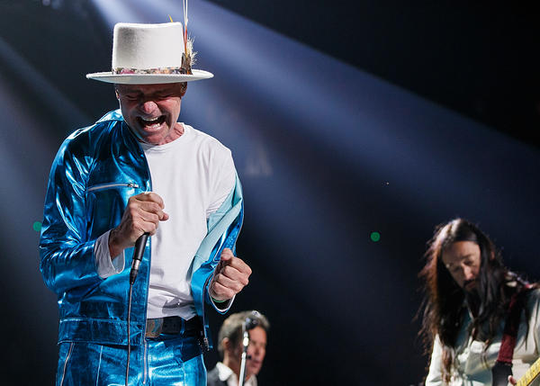 Gord Downie (left) performs with The Tragically Hip in Vancouver during the band's final tour in 2016.