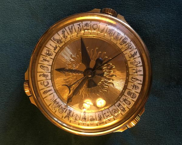 Pullman's own personal aletheiometer — the magical truth-telling device from his books.