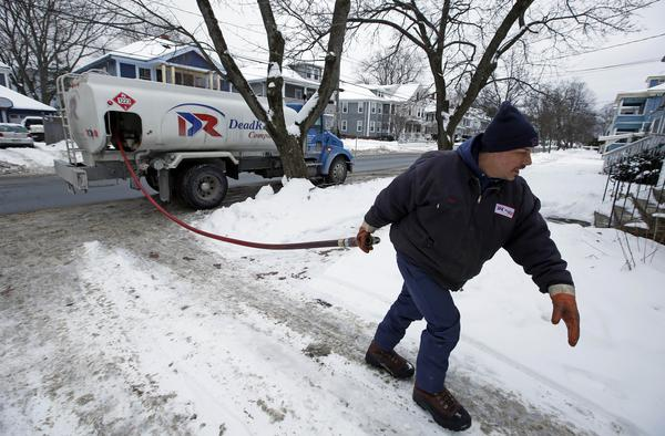 Paul Dorion, a driver for Downeast Energy, delivers heating oil in Portland, Maine. A new report by the Environmental Defense Fund alleges manipulation of the natural gas market in New England, which would make nongas-fired electricity more competitive.