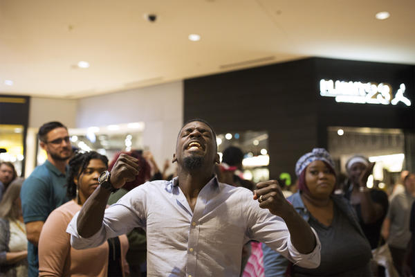 State Rep. Bruce Franks Jr. leads a chant inside the St. Louis Galleria on Sept. 30.