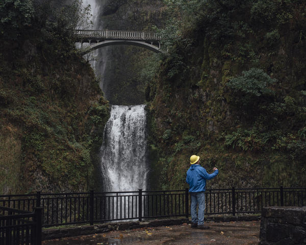 The fire danger at Oregon's Multnomah Falls has declined, but the famous landmark won't be reopening anytime soon.