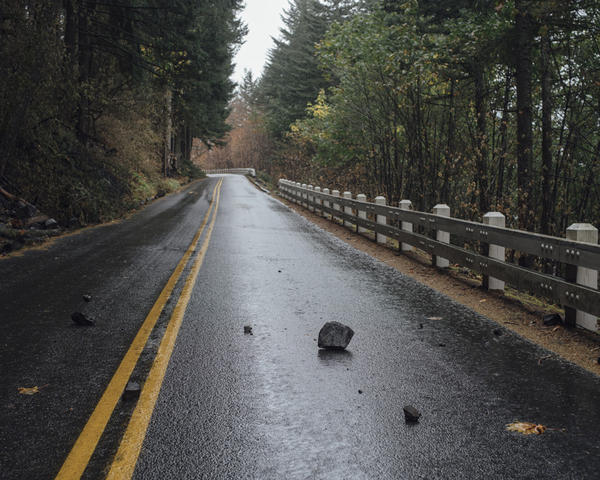 Rocks, some the size of basketballs, litter the old highway up to Multnomah Falls.