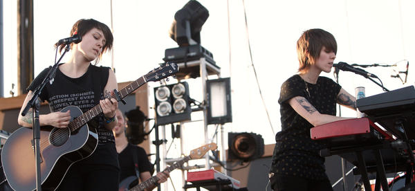 Tegan (left) and Sara Quin perform at Coachella in 2008, following the release of the duo's fifth album, <em>The Con</em>. Tegan and Sara are celebrating the 10th anniversary of <em>The Con </em>with a tour and an album of covers performed by musicians influenced by the original album.