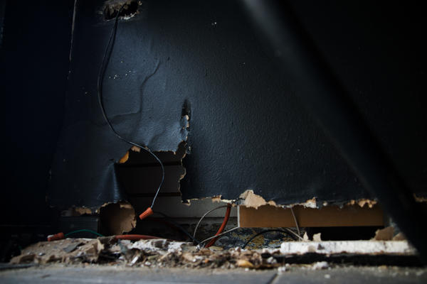 Electrical wires are exposed inside the restaurant.