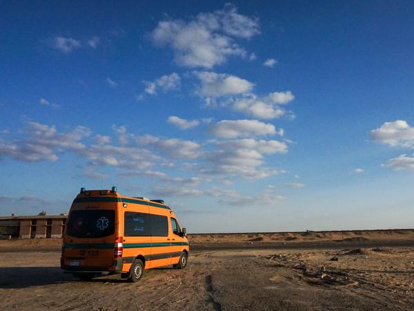 A picture taken on October 21, 2017 shows an Egyptian Health Ministry ambulance parked in the desert near the site of an attack that left dozens of police officers killed in an ambush by Islamist fighters.
