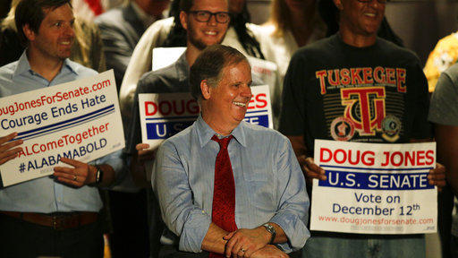 "Democrat Doug Jones speaks at a campaign rally earlier this month in Birmingham, Ala. He is campaigning on what he calls ""kitchen table"" issues, including health care, jobs and education."