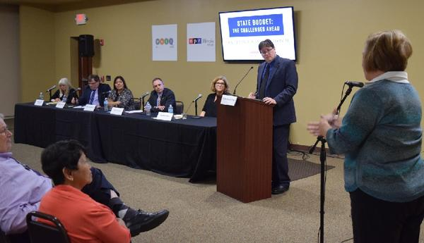 Panelists at the WNIJ/NPR Illinois forum this week on the aftermath of the Illinois budget impasse listen to a questioner at the event in DeKalb.