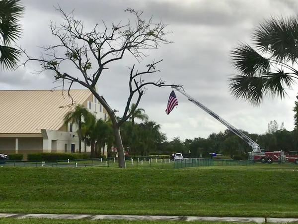 An American flag was flown over Christ the Rock Church in Cooper City, where family and friends of fallen Sgt. La David Johnson filled the pews to honor him.