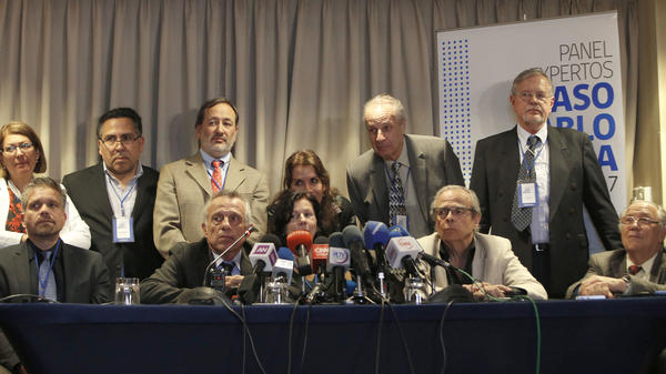 The panel of forensic experts, seen during a news conference Friday in Santiago. The group concluded that the poet and Nobel laureate did not die of cancer, despite what his death certificate says.