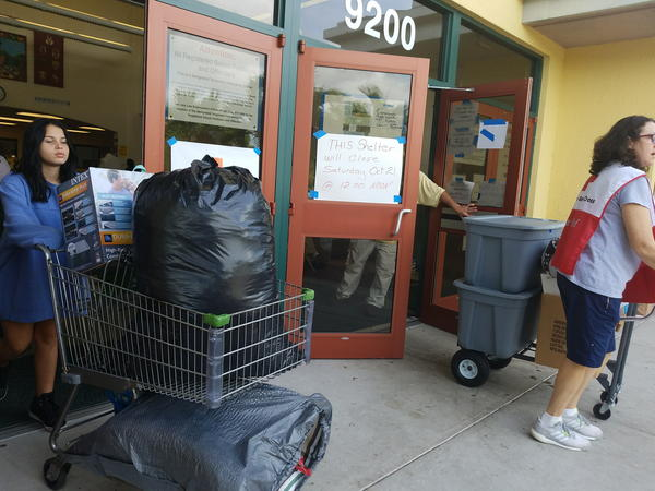 People leave the shelter Saturday--most going to transitional housing.