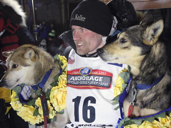 Dallas Seavey poses with his lead dogs Reef (left) and Tide after finishing the Iditarod Trail Sled Dog Race in Nome, Alaska, in March 2016. Seavey denies he administered banned drugs to his dogs in this year's race and has withdrawn from the 2018 race in protest.