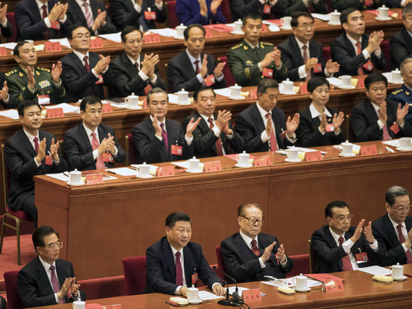 "Applause rained down for China's President Xi Jinping on Tuesday, as the Communist Party of China adopted his ""thought."" Xi (bottom center) was flanked by former presidents (from left) Hu Jintao and Jiang Zemin, along with Premier Li Keqiang."