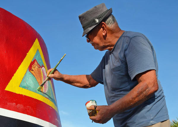 The original artists restored the paintings at the Southernmost Point Buoy in Key West.