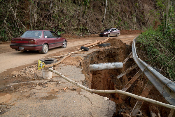 This damaged road in Maricao forces drivers to slow down almost one month after  Hurricane Maria tore through Puerto Rico.