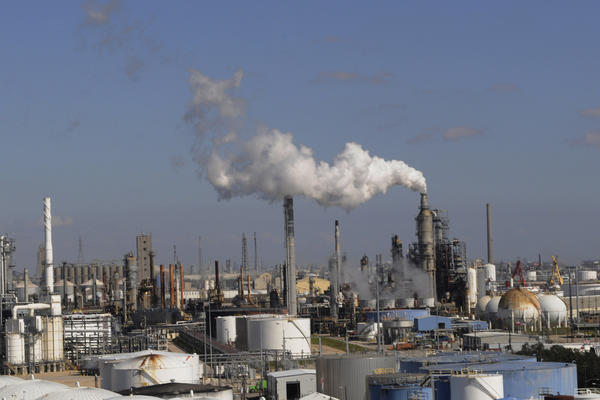 In this Feb. 25, 2010 file photo, refineries and chemical plants release steam near the Houston ship channel. (Pat Sullivan/AP)