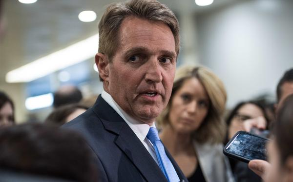 Sen. Jeff Flake, R-Ariz., speaks to reporters at the Capitol in April. On Tuesday, he announced he would not seek re-election.