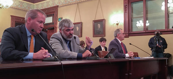 NRA lobbyist Todd Vandermyde, second from left, talks about bump stocks at a hearing of the Illinois House Judiciary Criminal Law Committee. Illinois State Rifle Assiciation lobbyist Ed Sullivan is at left; Rep. Marty Moylan, D-Des Plaines, is at right.