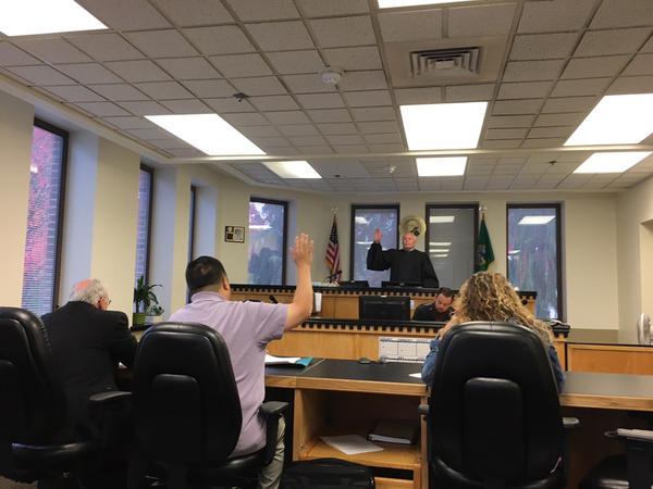 Pierce County Court Commissioner Craig Adams swears in a mental health professional during a hearing in civil commitment court. Adams has granted 90 percent of Joel's Law petitions that he has reviewed.
