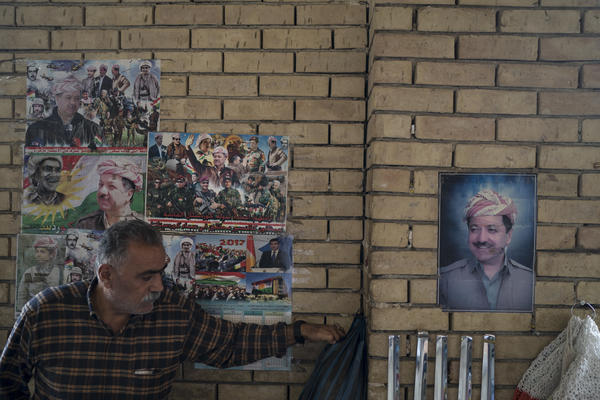 Photos of Kurdish president Masoud Barzani hang Wednesday on the walls of the central bazaar in Irbil, Iraq.