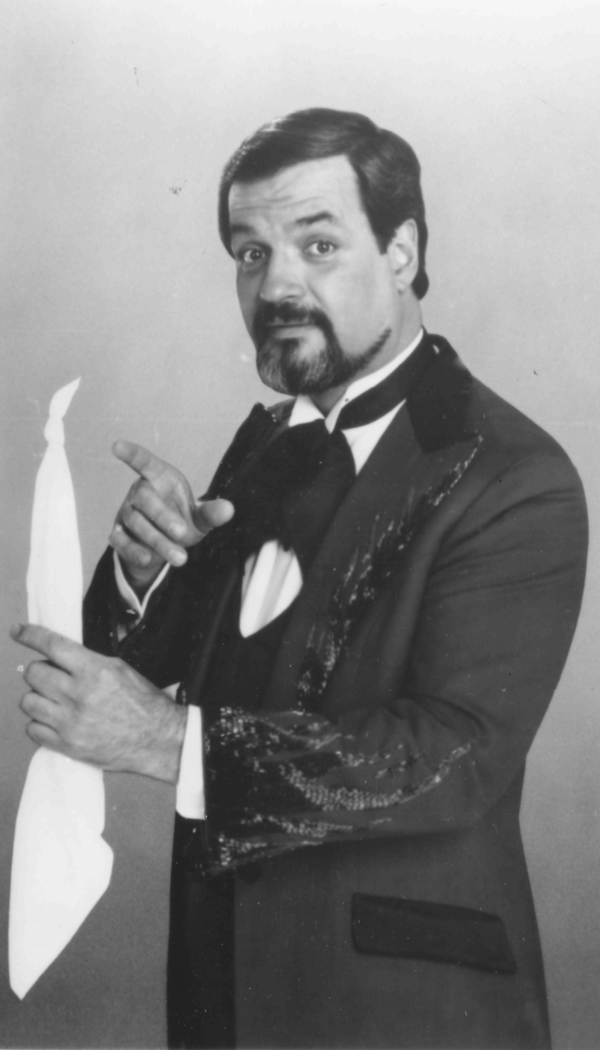 Harry Blackstone Jr., posing for the camera in the 1980s or 1990s, demonstrating the dancing handkerchief illusion his father made famous.