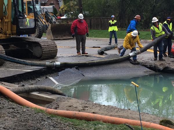 Crew fixing water main break at 14 Mile and Drake.