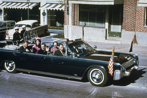 President John F. Kennedy, riding with first lady Jacqueline Kennedy, Texas Gov. John Connally and Connally's wife, Nellie, was shot shortly after this photo was taken.