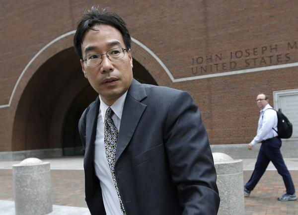 Glenn Chin, supervisory pharmacist at the now-closed New England Compounding Center, leaves federal court after attending the first day of his trial in Boston in Sept. He was found guilty of dozens of counts but acquitted of 25 counts of second-degree murder. (Steven Senne/AP)
