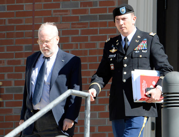 Attorneys for Army Sgt. Bowe Bergdahl — Eugene R. Fidell, left, and Army Lt. Col. Franklin D. Rosenblatt — leave the Ft. Bragg military courthouse on Thursday in Ft. Bragg, N.C.