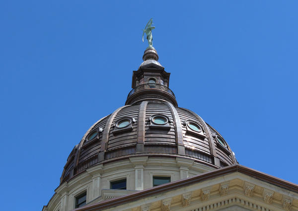 A female former legislative staff member says sexual harassment is widespread at the Kansas Statehouse.