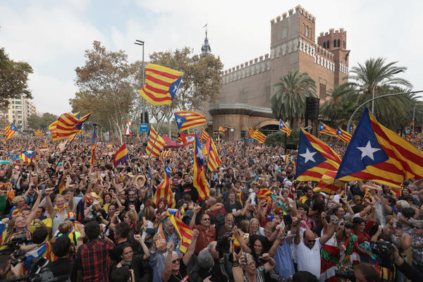 Catalan independence supporters react to the news that the regional parliament voted to declare independence from Spain, Friday in Barcelona.
