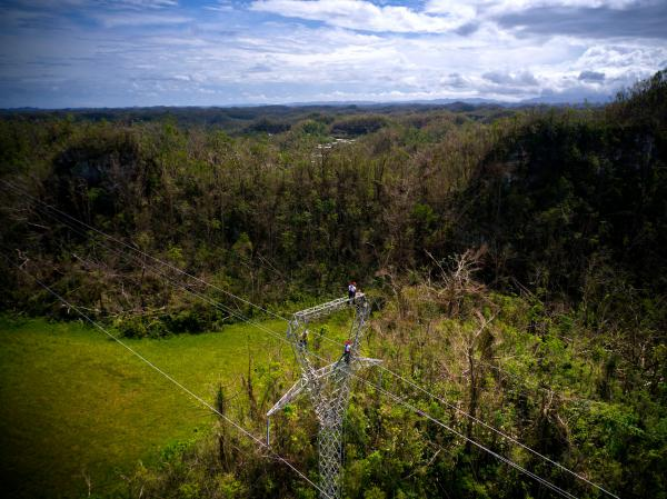 Whitefish Energy workers restore damaged lines in Barceloneta, Puerto Rico, on Oct. 15. A $300 million contract between the tiny company and Puerto Rico's electric authority has come under intense scrutiny.