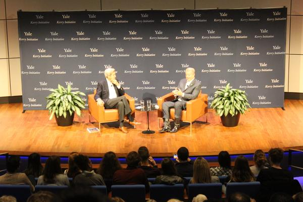 Former Secretary of State John Kerry talks with former Vice President Al Gore at Yale on Thursday.