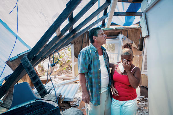 Ana Ramos, 58, and husband Jeff Rearden, 53, stand in the remains of their home in Maunabo, a town in south Puerto Rico. Hurricane Maria destroyed the roof and walls of the house.