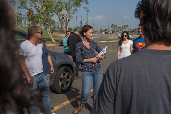 Coordinator Ariadna Godreau explains to a group of lawyers and law students how to help hurricane survivors fill out FEMA forms. The volunteers met in front of a Home Depot in San Juan.