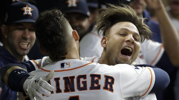 Houston Astros' Yuli Gurriel celebrates his second-inning home run in Game 3 of the World Series against the Los Angeles Dodgers on Friday.