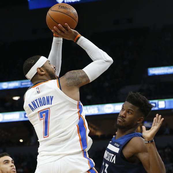 Oklahoma City Thunder's Carmelo Anthony shoots over Minnesota Timberwolves' Jimmy Butler during a game Friday in Minneapolis. The Thunder had a rocky flight to Chicago after the game.