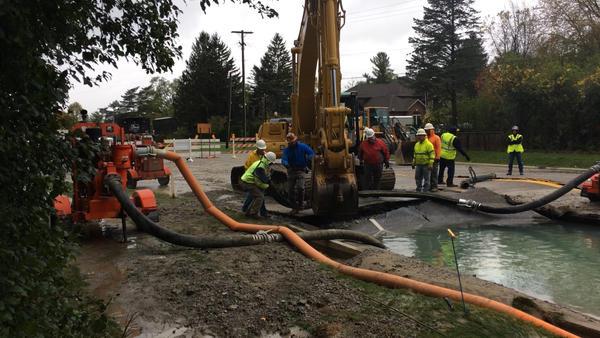 Workers repair the water main break in Farmington Hills.