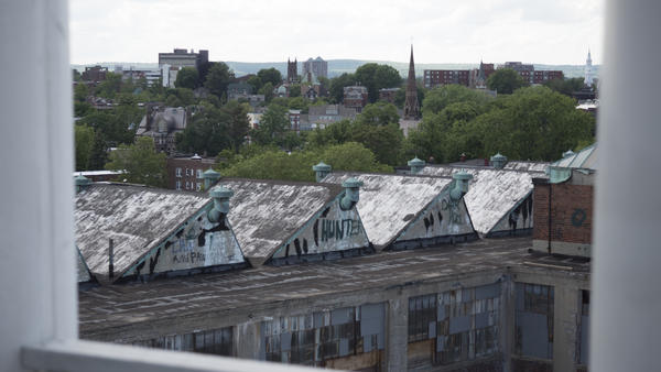 One of the Colt factory buildings that has yet to be renovated, seen from the onion dome. Colt Gateway plans to build 93 more apartment units in this building.