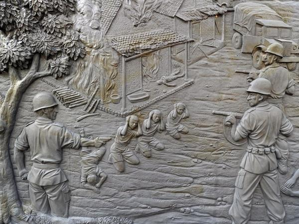 A mural at the Rawagede monument of independence (shown here on Sept. 15) depicts the 1947 massacre by Dutch military troops. The Dutch government long ago admitted to the killings and donated money to the village — but refused to link the funds to the massacre.