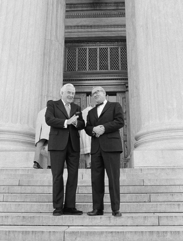<p><strong>December 1975:</strong> Chief Justice Warren Burger (left) talks with Stevens on the steps of the Supreme Court before Stevens' swearing in as the 101st justice.</p>