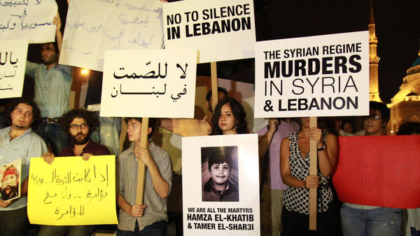 <p>Lebanese and Syrian protesters demonstrate against the Syrian government in Beirut in August. Syrian defectors say they fear the Syrian regime will track them down, even in Lebanon.</p>