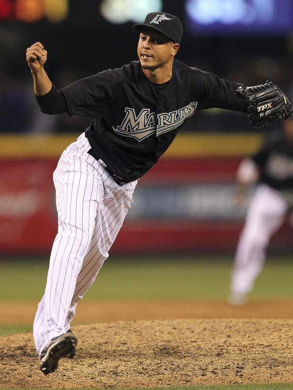 <p>Juan Carlos Oviedo, seen here closing a game for the Marlins under the name Leo Nunez, remains in the Dominican Republic after admitting falsifying documents.</p>