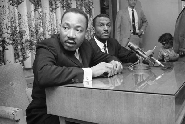 <p>At a news conference in 1963, the Rev. Martin Luther King Jr. and Shuttlesworth tell the media that massive demonstrations will continue in Birmingham.</p>