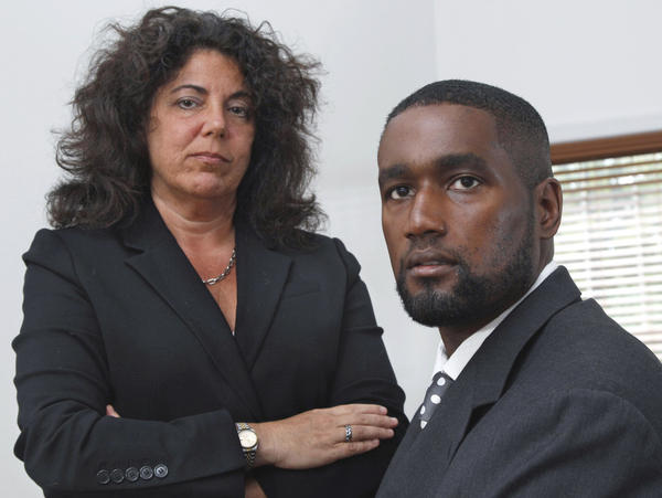 <p>Albert Florence (right) sits at his home in Bordentown, N.J., on Tuesday with his attorney Susan Chana Lask. He challenged his strip search after a wrongful arrest on minor charges. </p>
