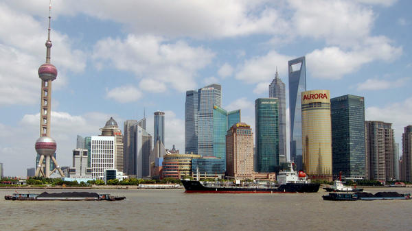 <p>Lujiazui, Shanghai's financial district, includes the world's third- and sixth-tallest buildings. The city's population is 23 million.</p>