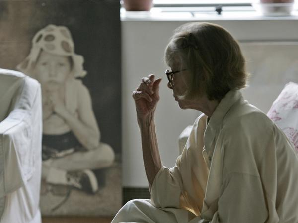 <p>Didion looks at a painting of her daughter in her New York apartment.</p>