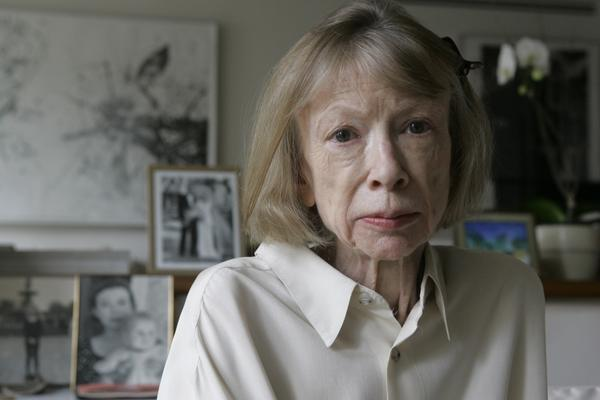 <p>Sitting behind Didion in her New York apartment are photographs of herself holding Quintana Roo, and a photograph from Quintana Roo's 2003 wedding.</p>