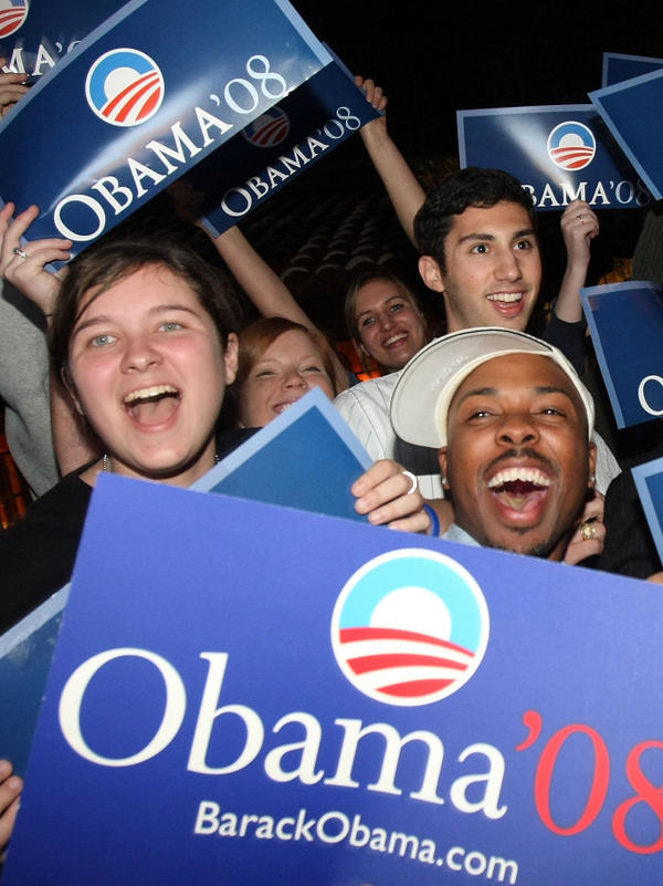 In 2008, Obama won the support of young and minority voters with his message of hope and change. Here, supporters of the then-presidential candidate cheer as they watch results from the Louisiana presidential primary in February 2008.