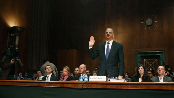 "U.S. Attorney General Eric Holder is sworn in before testifying during a Senate Judiciary Committee hearing about the controversial ""Fast and Furious"" gun-trafficking program on Tuesday."